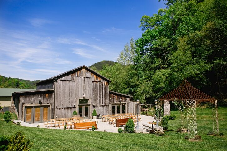 The intimate patio at the Barn at Chestnut Springs in Sevierville, Tennessee, doubled as a pretty ceremony space and a dance floor illuminated by bistro lights. Nearby on the lawn, guests played corn hole and gathered around the outdoor fireplace for a s'mores bar.