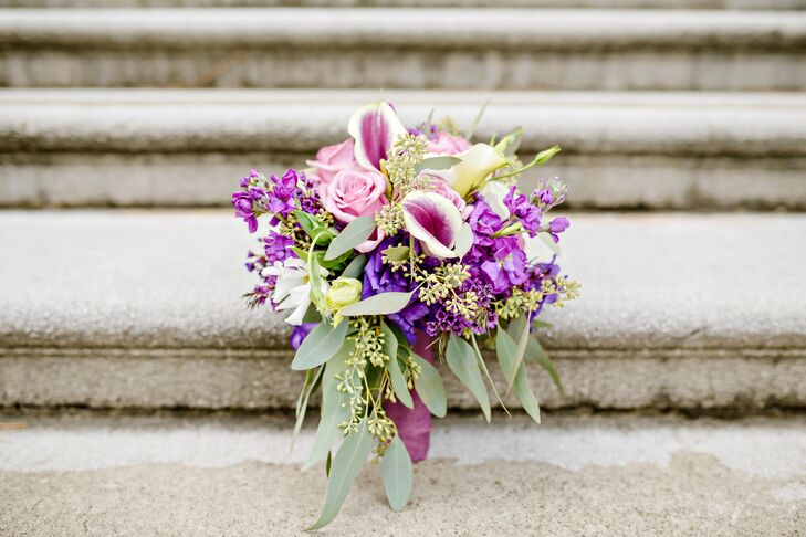 Stephanie's brilliant purple bouquet was filled with Picasso calla lilies, roses, stock, seeded eucalyptus and cascading eucalyptus leaves.