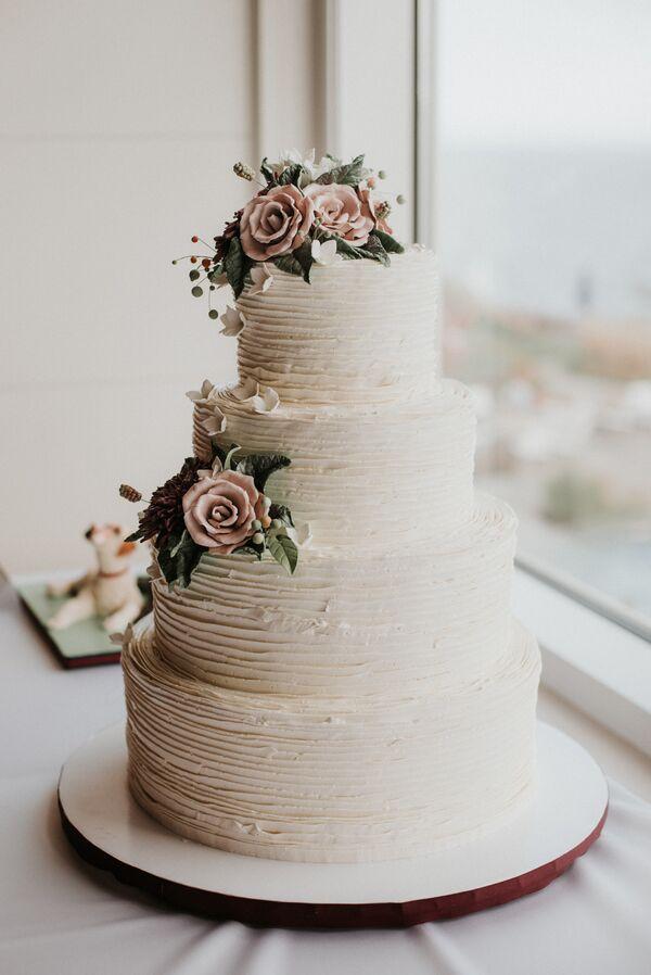 Textured Ivory Wedding Cake With Fondant Roses