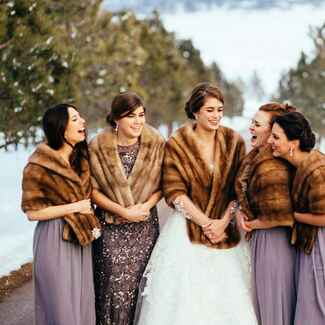 Bride with bridesmaids wearing fur stoles
