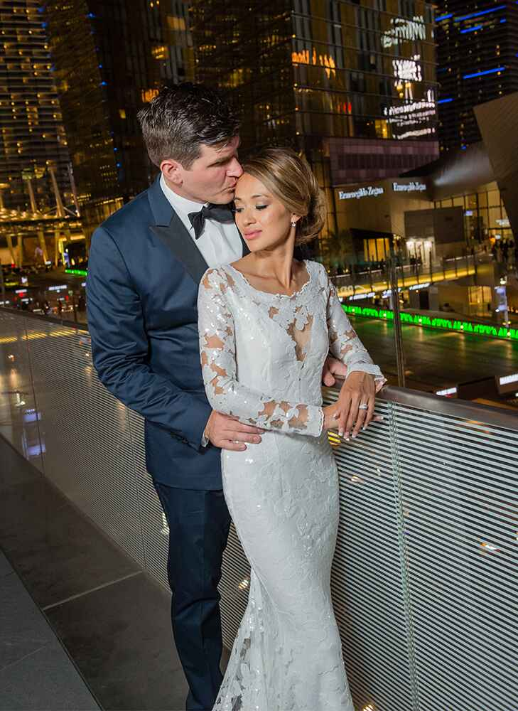couple posing outside at the mandarin oriental during their wedding reception in las vegas