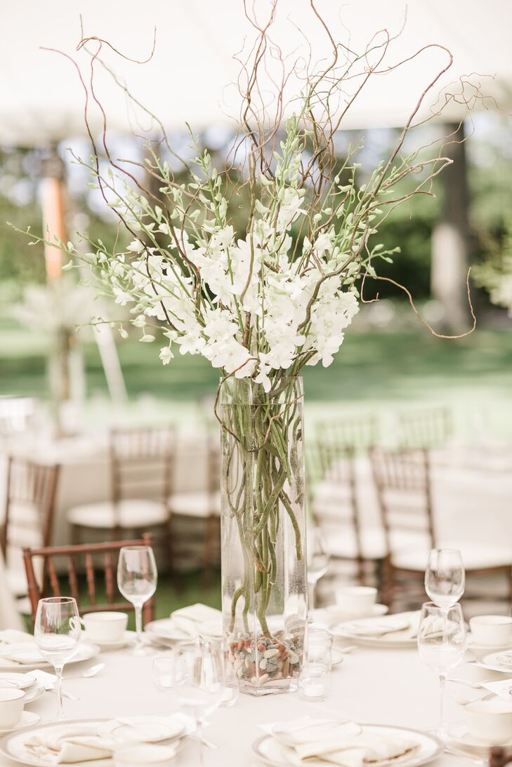 White stock and branches tall centerpiece