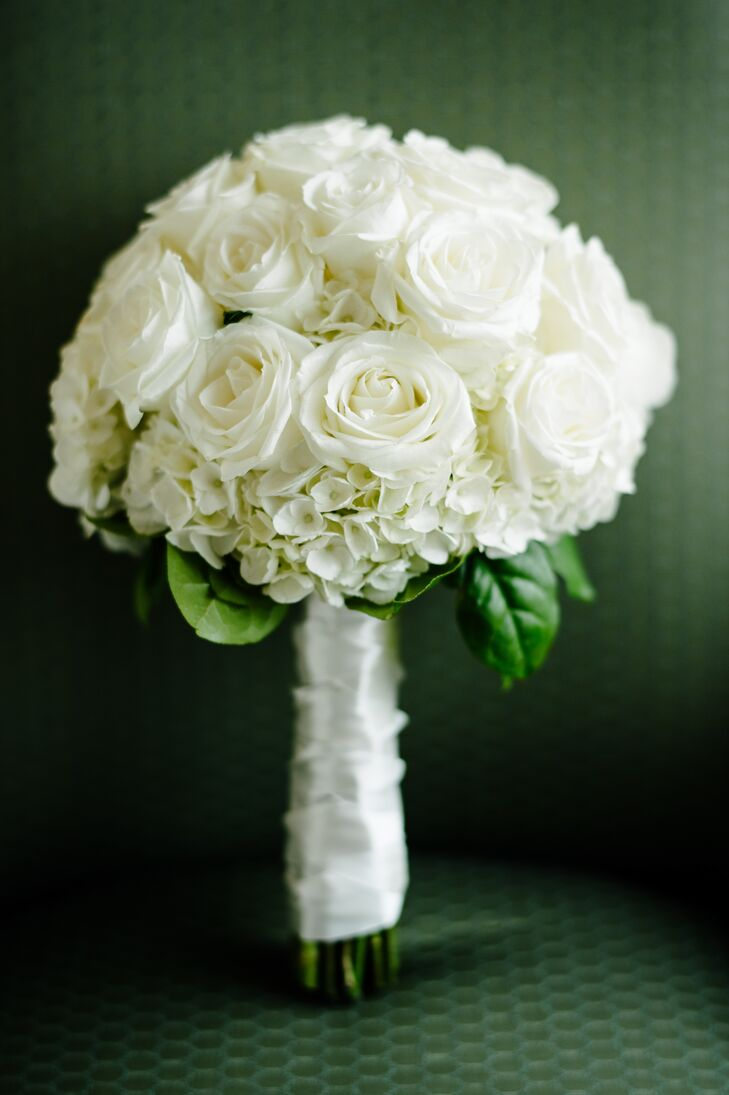 Meredith's bouquet had a classic, elegant feel. The bouquet was filled with ivory roses and hydrangeas and was wrapped with a length of white ribbon.