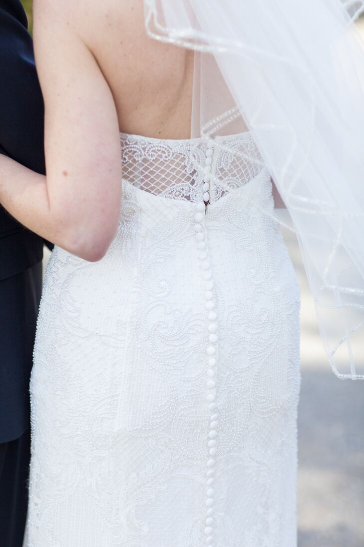 "The back of Lisa's Oleg Cassini dress had a tulle inlay and featured buttons all the way down the back. ""I knew it was the perfect gown for me when I put on a veil and my mother, sister, niece and I all broke into tears,"" she says."