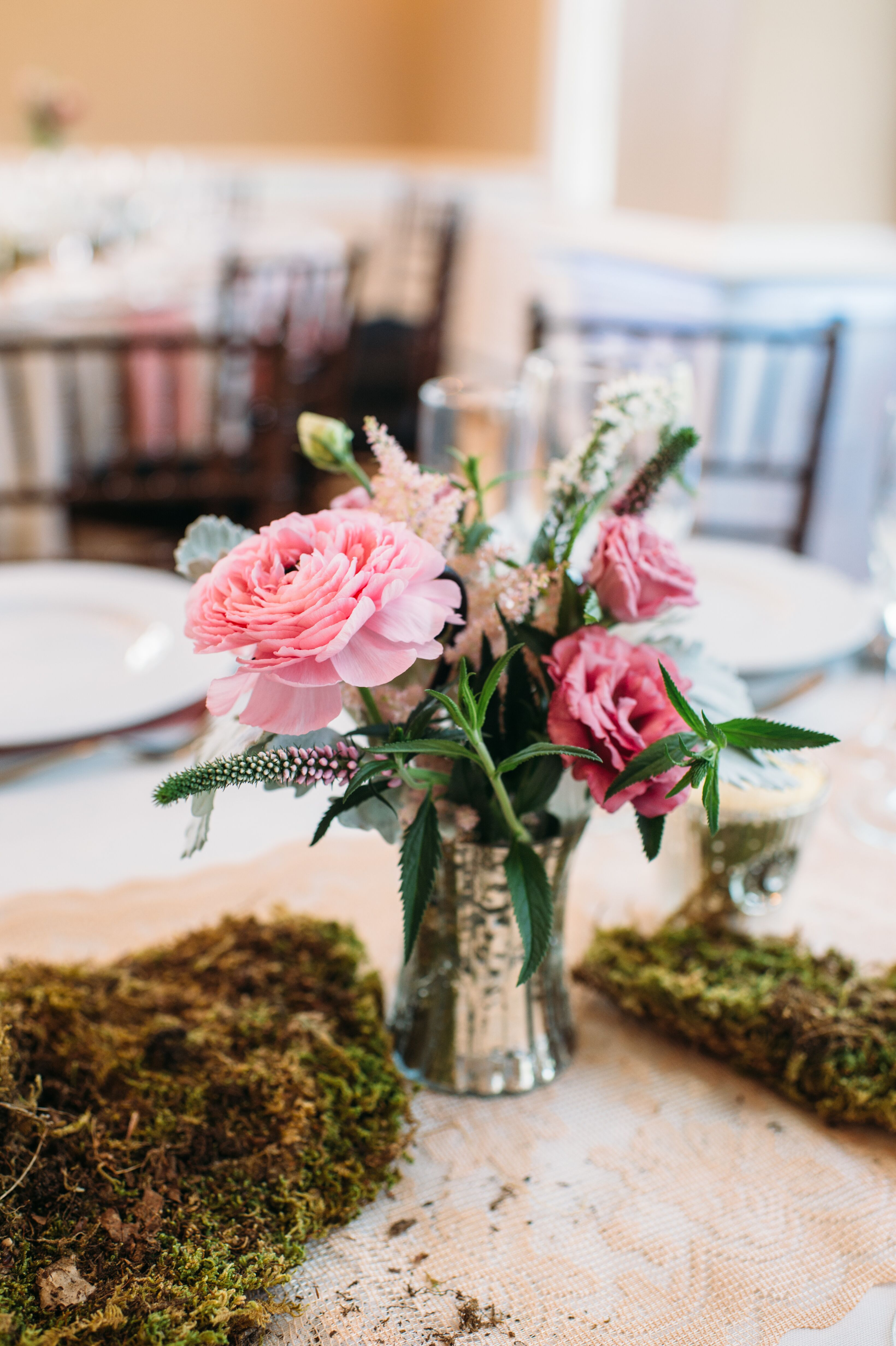 Pink ranunculus lisianthus and astilbe centerpiece