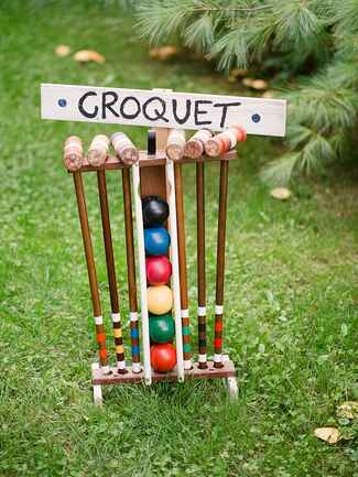 Outdoor lawn game party ideas for a rustic camp wedding