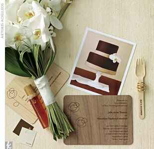 wooden invitations and a white bouquet