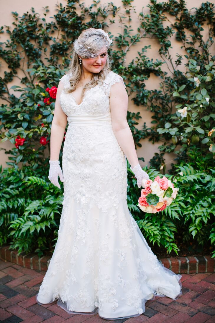 "When it came time to find the perfect dress, Jackie knew exactly where to go. ""My mom and one of her sisters bought their wedding gowns at Yvonne Lafleur in New Orleans, so it just made sense to me to go there first. And once you find the perfect dress, you don't keep looking!"" says Jackie. She decided on a lace mermaid gown with an empire waist and lace cap sleeves."