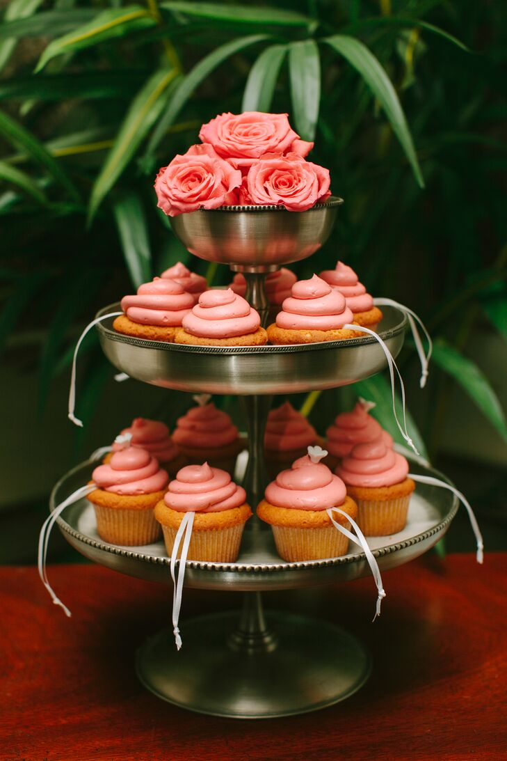 For all the single female guests in attendance, the couple decided to do cake pulls, a Louisiana tradition where single friends of the bride pull silver charms, each with a specific meaning, from the bottom layer of the cake before it's cut. Instead of placing the pulls in the cake itself, Jackie gave each girl a pink-frosted cupcake with a charm on top.