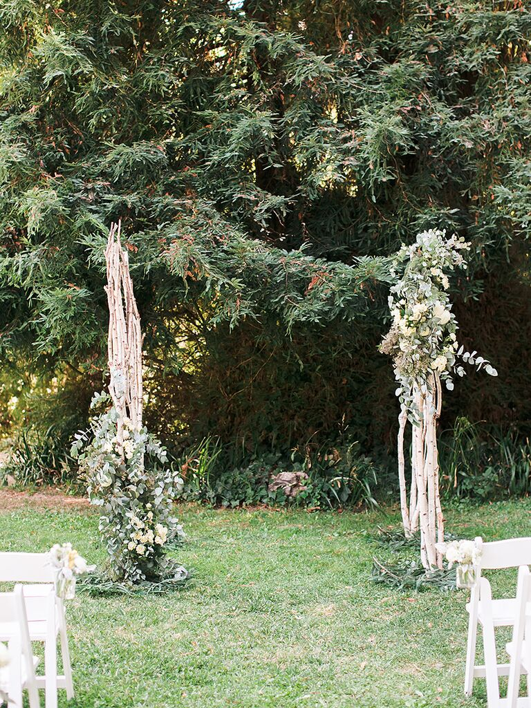A Simple Rustic Wood And Greenery Arch For An Outdoor Wedding