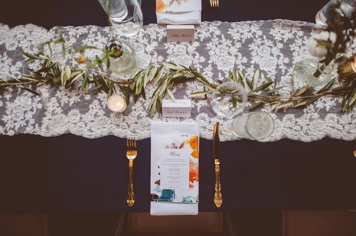 Gold silverware and lace table runners added a romantic touch to the table decor.