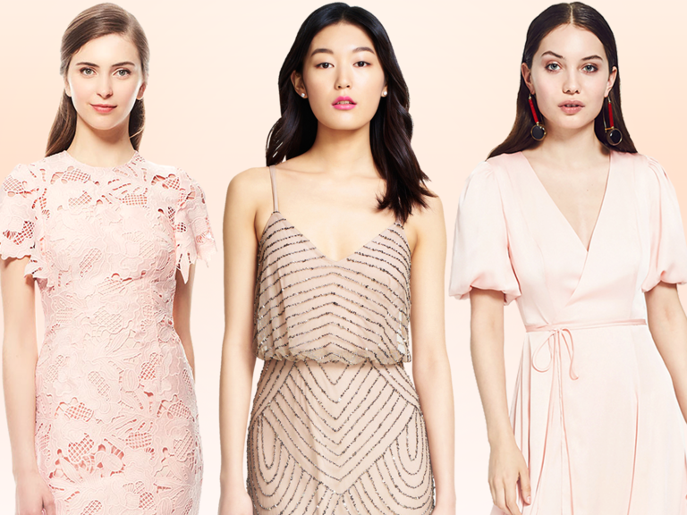 Blush bridesmaid dresses during bridesmaid first look with bride