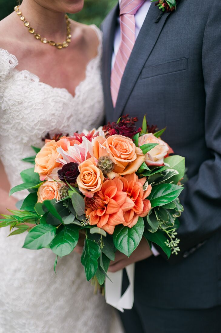 Christine held a loosely arranged bouquet with an organic style, filled with roses, dahlias, jasmine and scabiosa pods that followed the fall-inspired palette.