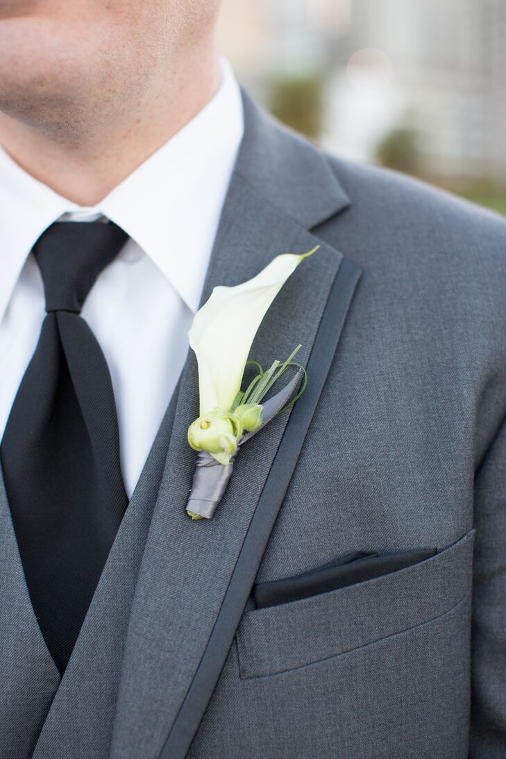 Patrick had a single white calla lily pinned to his charcoal gray suit jacket, matching the rest of the arrangements filled with white flowers.