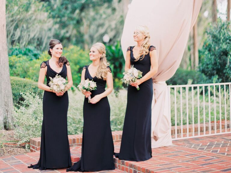Bridesmaids in black full length dresses