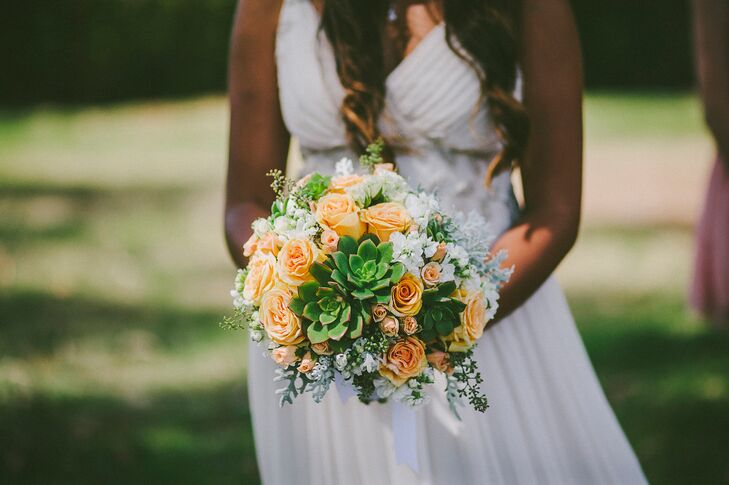 Dewi held a DIY lush bouquet filled with peach roses, green succulents and white stock.