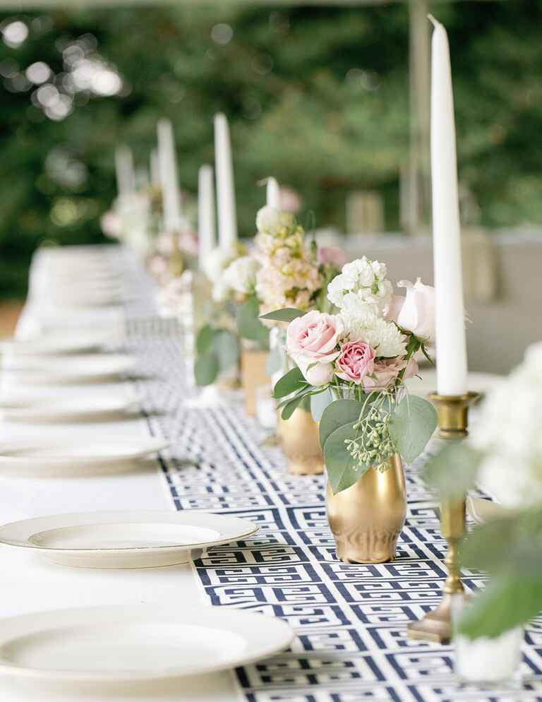 White and blue patterned table running with tall taper candles