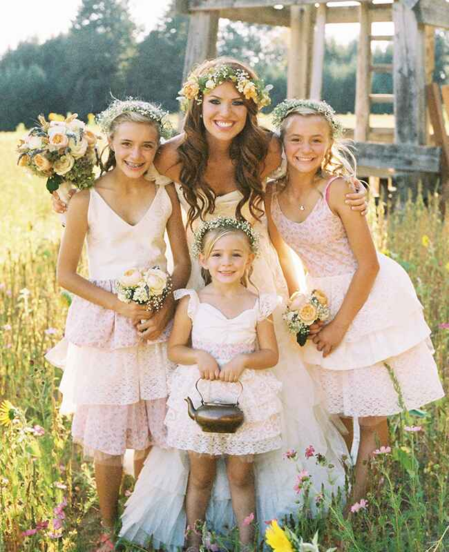 Audrey Rploff poses with her flower girls
