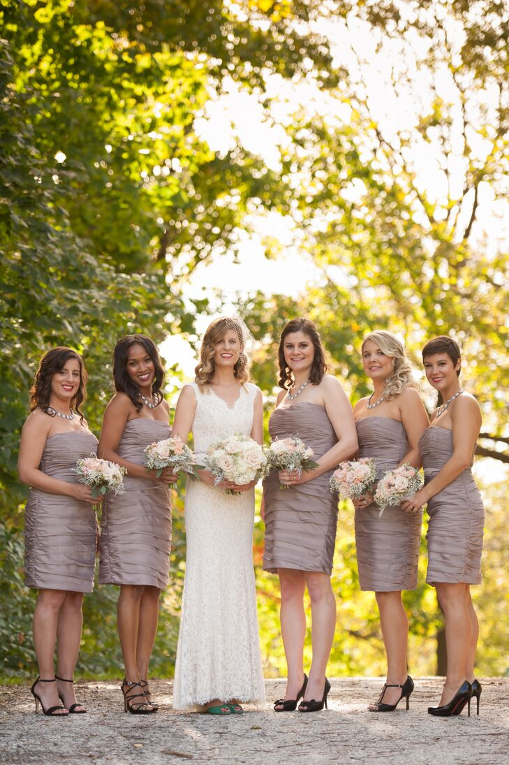 Megan's bridesmaids wore strapless, knee-length dresses in taupe by Monique Lhuillier. They paired their dresses with their own black heels and carried pink rose bouquets similar to Megan's bouquet.
