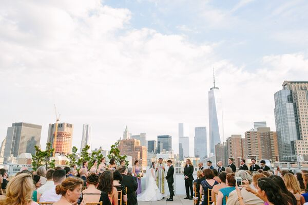 Beautiful Outdoor Wedding Ceremony At Tribeca Rooftop: Mismatched Purple Bridesmaid Dresses