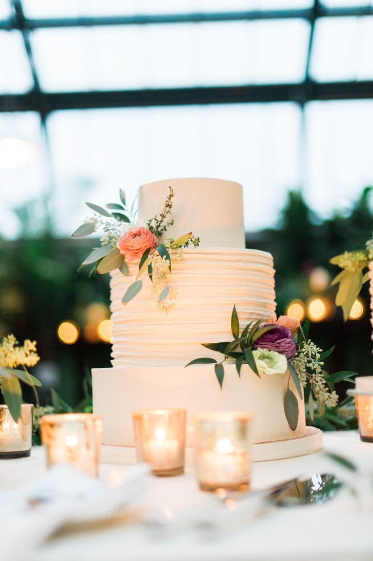 Sweet Heather Anne's bakery created this three tier buttercream cake for the couple's covered reception. As a sweet way to treat guests, the newlyweds had single-serving cake boxes on hand so family and friends could enjoy dessert at home.
