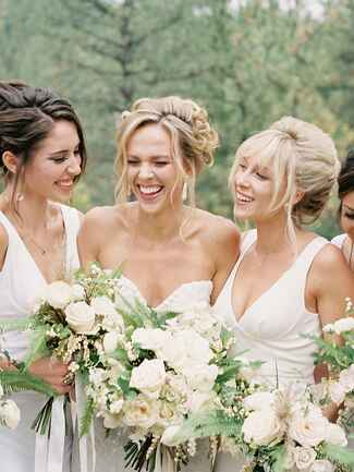 Loose bridesmaid updo hairstyle with bangs