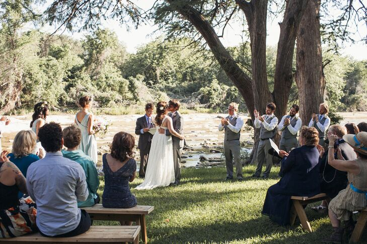 A grove of trees beautifully framed the bank of the Blanco River at Rocky River Ranch, where Courtney and Mark exchanged their vows.