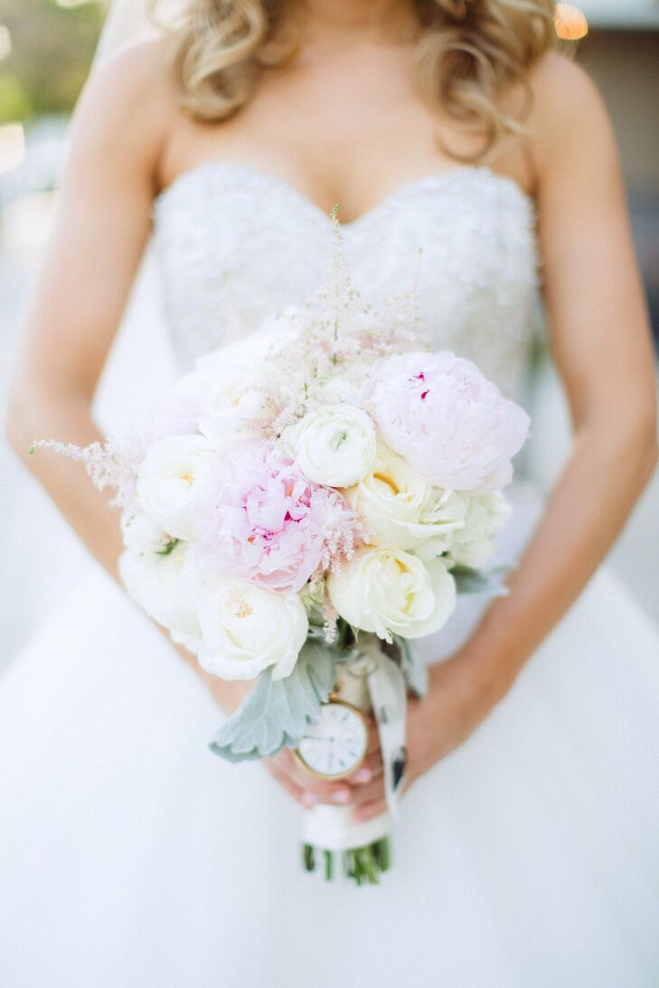The bridal bouquet was a lovely, soft arrangement of white and pink peonies, ranunculuses and roses.