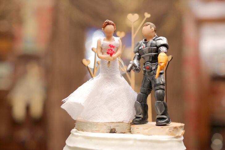 The cake toppers were handmade by a bridesmaid to look like the bride and groom (with a little whimsy).