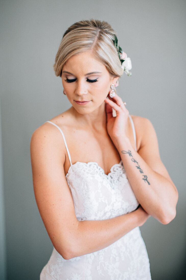 "Ashley wore a fitted A-line gown with delicate straps and a tea rose blush underlay and ivory lace overlay. Makeup was ""natural with a touch of glam,"" amped up for the special occasion."