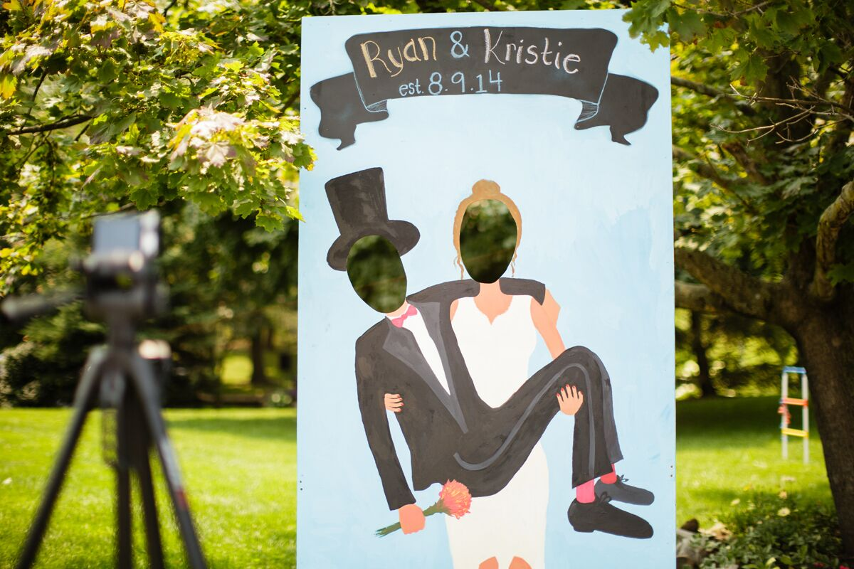 DIY Bride and Groom Cutout Photo Booth