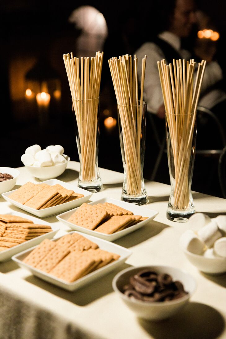 When guests needed a break from dancing, they visited Katie and Dave's s'mores bar, where they toasted marshmallows and indulged in campfire treats.