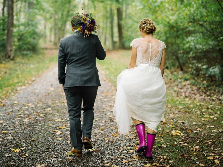 newly weds walking outdoors