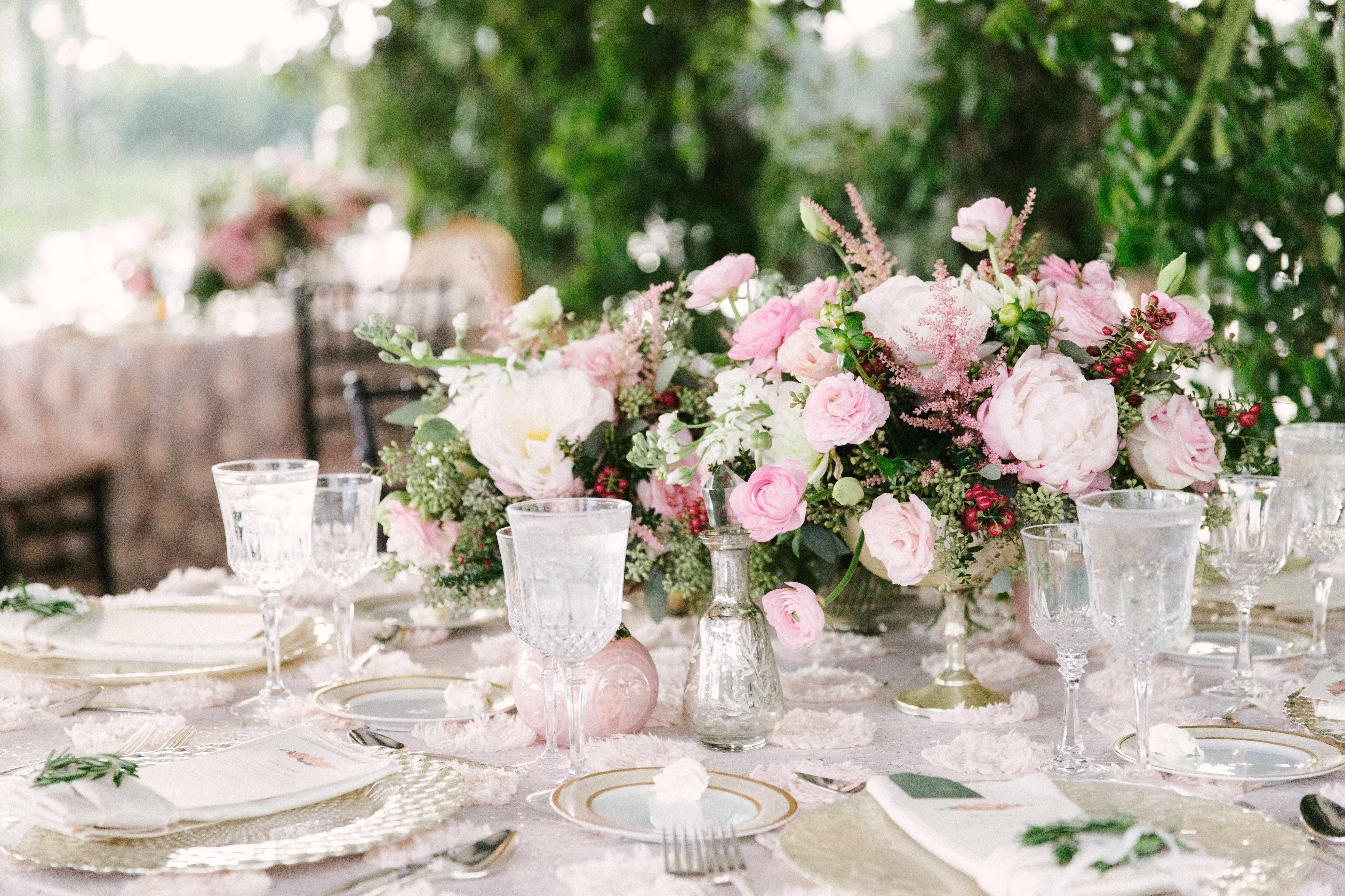 Overflowing pink lavender ranunculus and peony centerpiece