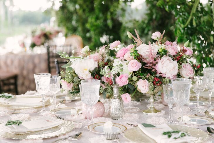 "Each round or family-style table included a lush arrangement of blush and cream ranunculus, roses, garden roses, peonies and lavender in mercury vases. Each was surrounded by silver accents and tealight candles. ""We wanted to give the feeling at each table of a garden tea party,"" says Joyce."