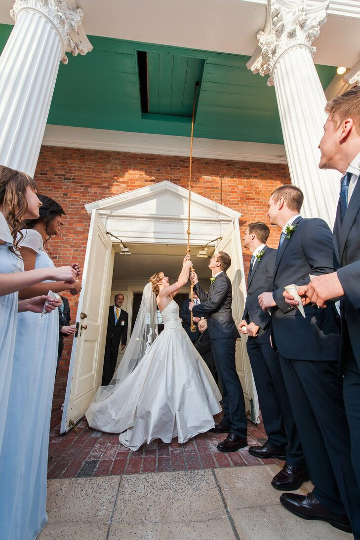 After the ceremony, the couple rang the bell outside of The Henry Ford chapel.
