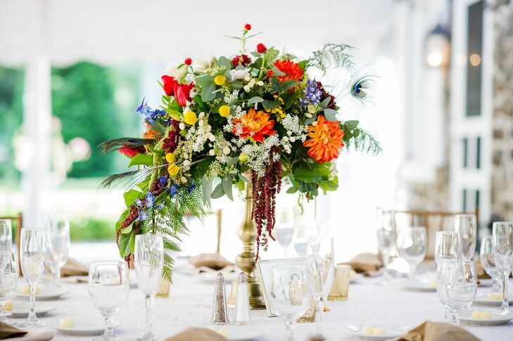 A gold compote was filled with an assortment of garden rose, ruscus, zinnia, tulip, hydrangea and gomphrena.