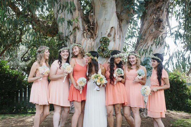 """The bridesmaids wore a light coral dress of their choosing and baby's breath flower crowns made by the bride's mother and aunts,"" the couple says."