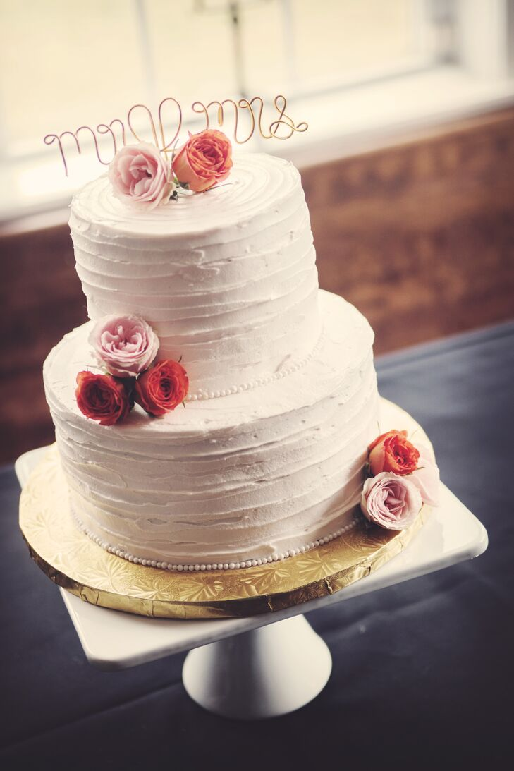 two tier wedding cakes with roses two tier buttercream wedding cake with pink flowers and 21373