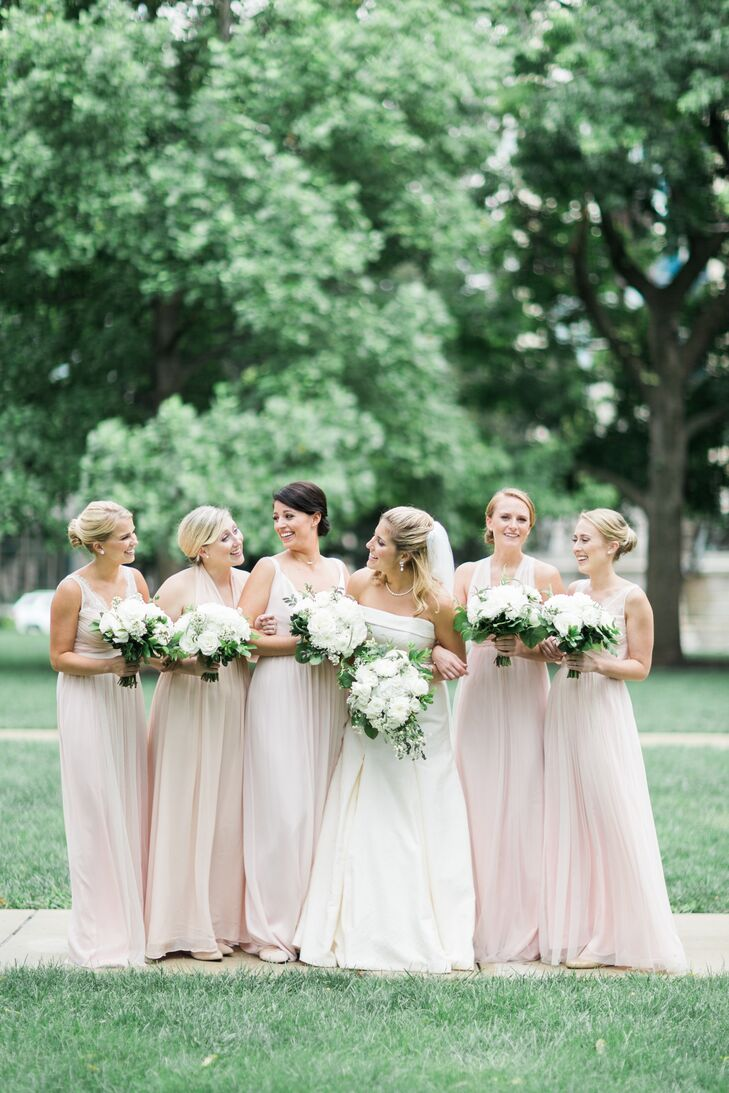 "Margaret wanted her five bridesmaids to wear floor-length gowns in the same pink shade but was open to style. After a trip to BHLDN in New York, they found the dresses. ""We ended up with three different dresses, all in the same color family, and each dress looked stunning,"" she says."