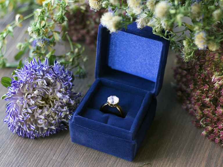 engagement ring in blue velvet ring box