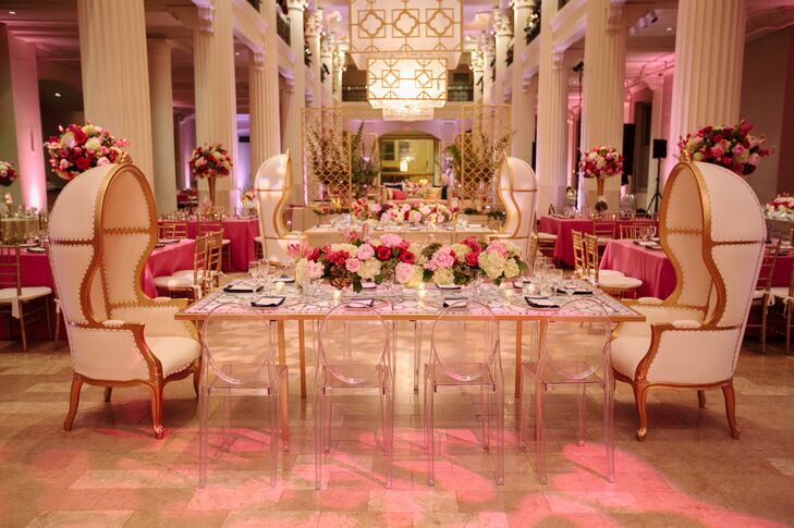 For the rectangular dining tables, Naina and Scott printed the quatrefoil pattern from their invitations and used it as a graphic for the tabletop. The floral arrangements were colorful and spanned the length of the table. Ghost chairs on the sides and comfortable dome chairs on the ends added drama to the setting.