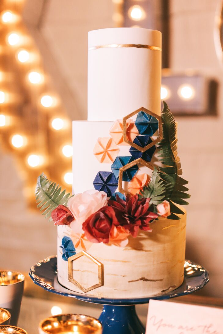 Keeping with the stitching theme, the ivory wedding cake showcased a cascade of hexagonal shapes designed to resemble quilt squares.