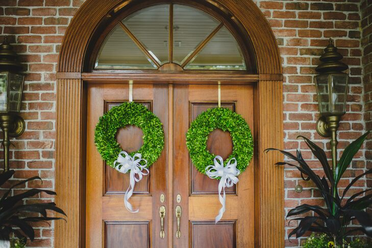 The spot where Brooklee and her bridesmaids got ready, also brought in a little of their natural flair. Blooms made these twin wreaths covered in greenery and accented with white ribbon bows for the wedding.