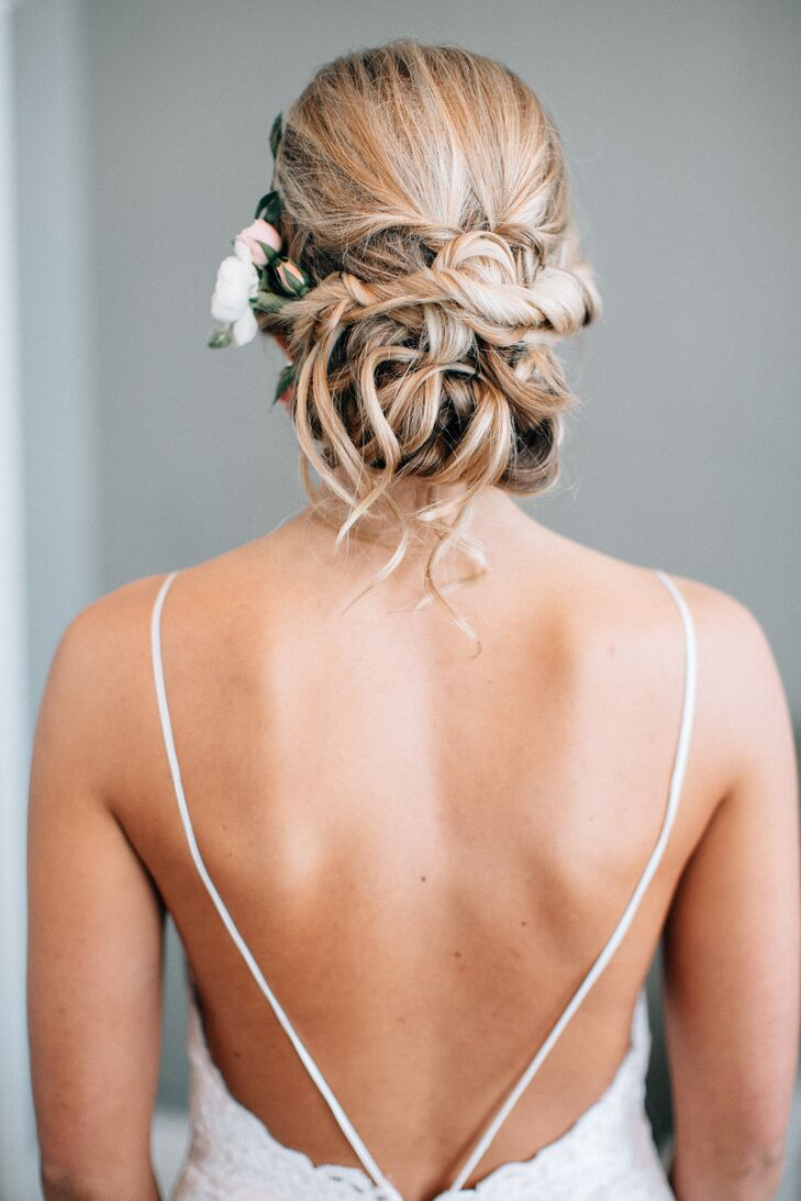 """My favorite part of the dress was the open back,"" Ashley says. She wore her hair up in loose curls for a soft, romantic look."