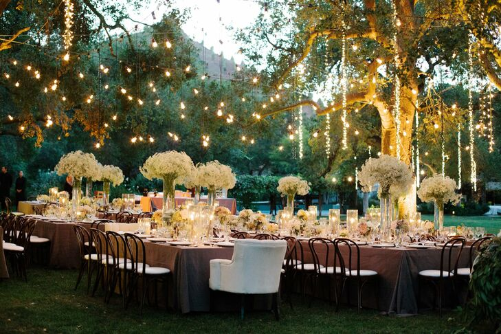 Bistro and fairy lights were hung over the reception tables and casting a warm, inviting glow over the space.