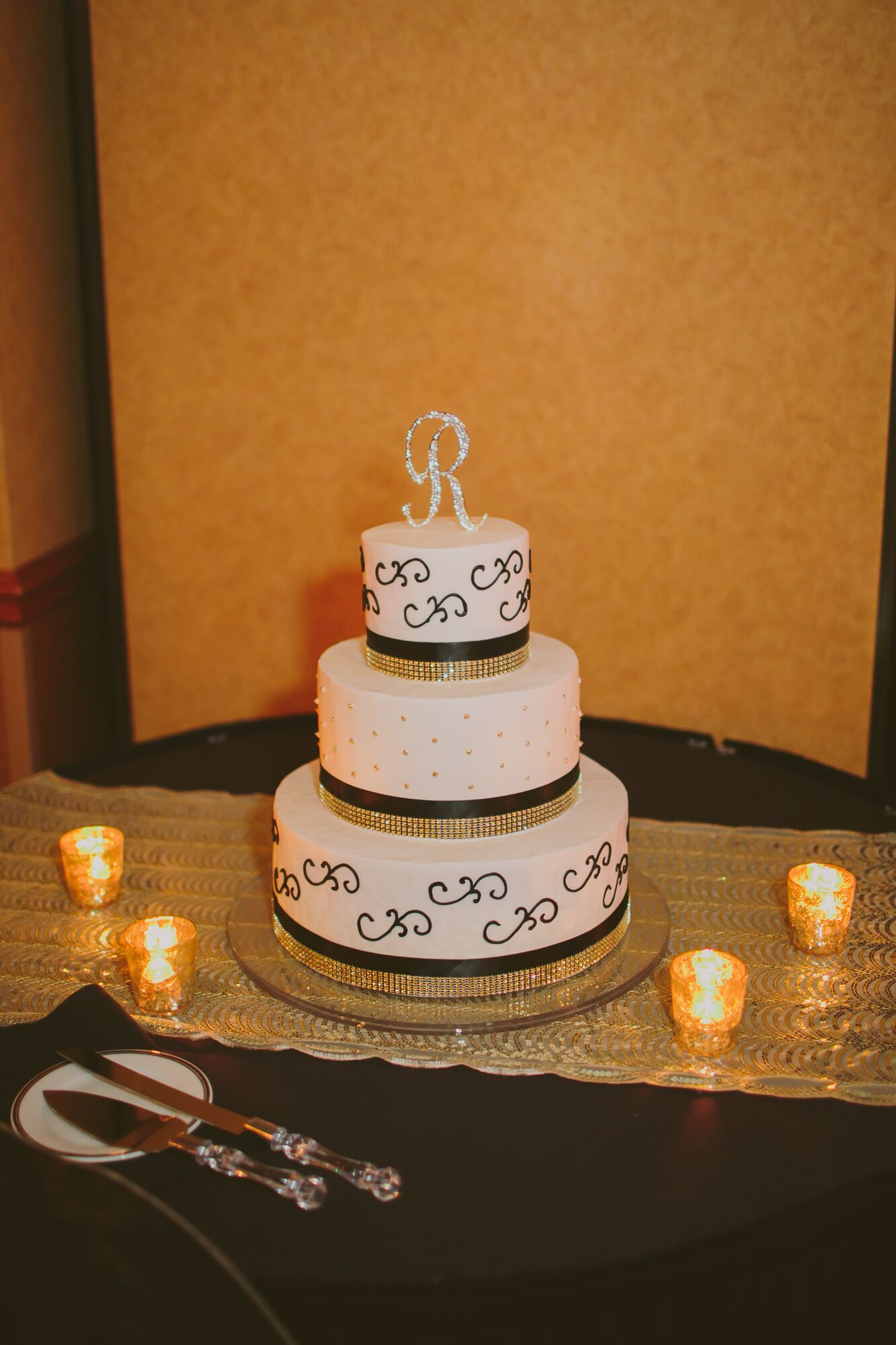 wedding cake with gold ribbon tiered white wedding cake with black and gold ribbon and 26902