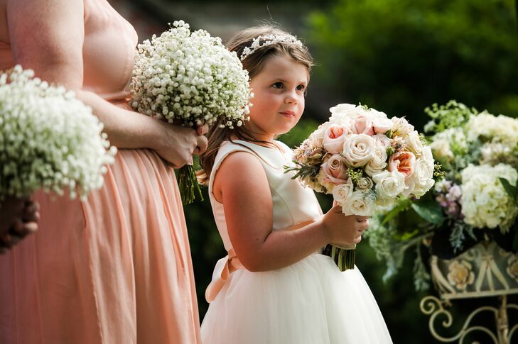 The flower girl held Lori's bouquet during the vows.