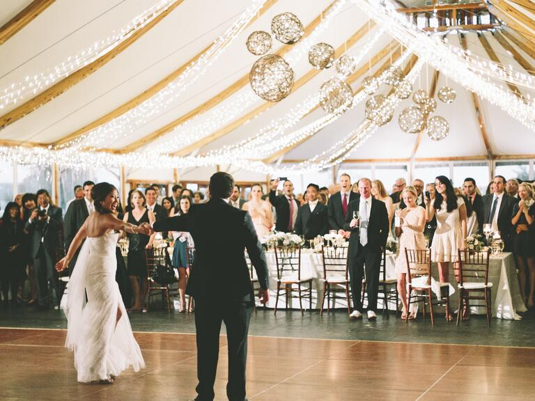 Bride and groom's first dance at tented wedding reception