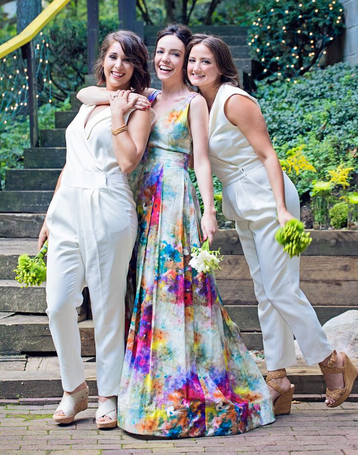 "Both of Natalie's bridesmaids donned Rachel Zoe jumpsuits in lieu of traditional bridesmaid dresses. ""There is something inherently uncool about two girls wearing the same short white dress and standing next to each other – it just didn't sit right with me,"" Natalie says. ""Plus, I've always been more of a pants person – so the idea of bridesmaids in white pants and a white blouse seemed so perfect – it was exactly what I would've wanted to wear as a bridesmaid."""